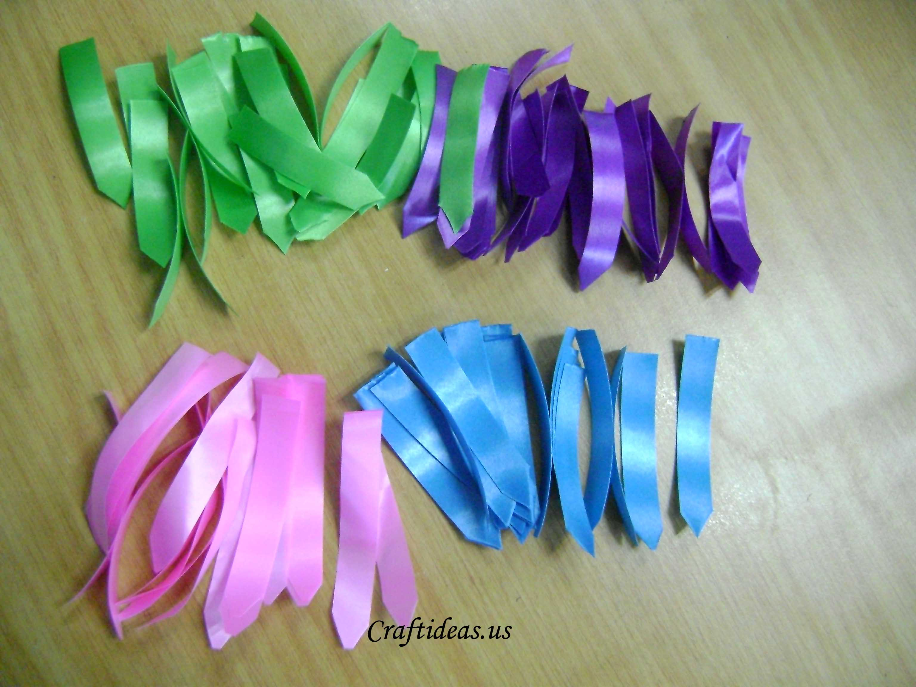 Spring flowers ribbon flowers tutorial craft ideas step 2 cutting in haft a4 paper rolling each part in to have small sheet and use glue to stick it mightylinksfo